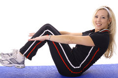 Female doing pilates Royalty Free Stock Photo