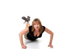 Female doing push ups isolated Royalty Free Stock Image