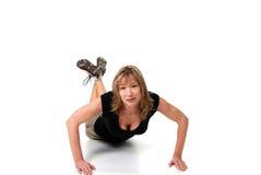Female doing push ups isolated Royalty Free Stock Image
