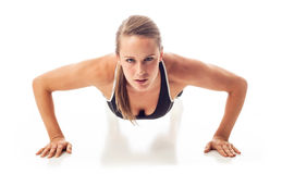 Female doing pushups Stock Photography