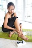 Female doing self foot massage Stock Photo