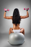 Female doing shoulder press Stock Image
