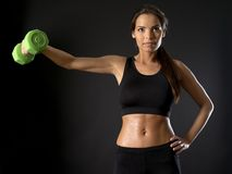 Female doing side shoulder fly Stock Photography