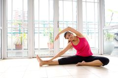 Female doing stretching exercise stock image