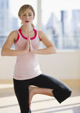 Female doing yoga alone in studio Stock Photography