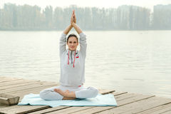 Female doing yoga exercise   outdoor in the city park Stock Image