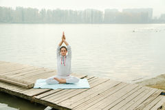 Female doing yoga exercise   outdoor in the city park Stock Photos
