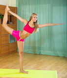 Female doing yoga at home Stock Photos