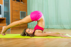 Female doing yoga at home Royalty Free Stock Photography