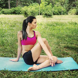 Female doing youga exercise   outdoor in the city park Royalty Free Stock Images