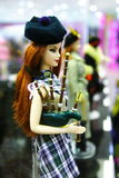 Female doll. Wearing a dress of Scotland Royalty Free Stock Photos