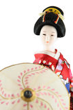 Female doll from Japan. With umbrella on a white background Stock Images