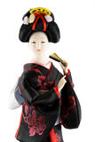 Female doll from Japan. With a fan on a white background Stock Photography