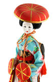 Female doll from Japan. With red hats on a white background Stock Photography