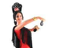 Female doll from Spain dancing. Flamenco on a white background Stock Images