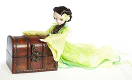 Female doll and treasure box Stock Photos