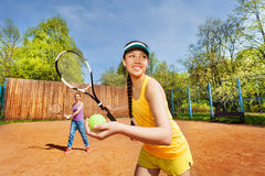 Female double tennis partners preparing to serve Royalty Free Stock Images