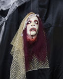 Female dracula monster head with bloody fangs and purple hair Stock Image
