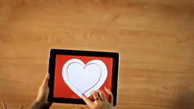 Female drawing heart insight heart on tablet stock footage
