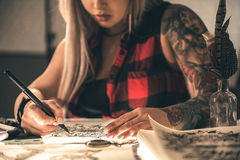 Female drawing image by pen Royalty Free Stock Photography