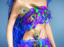 Female Dress Made of Feathers Stock Photo