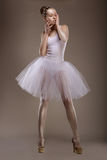 Charming Woman in White Tutu with Pearly Beads over Grey. Ballet Stock Photography