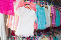 Female dresses on hangers. At clothes store royalty free stock photos