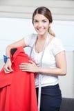 Female Dressmaker Adjusting Clothes Stock Photo