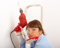 Female drilling hole Stock Photography