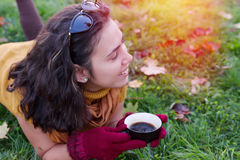 Female drinking cup of coffee in nature Stock Images