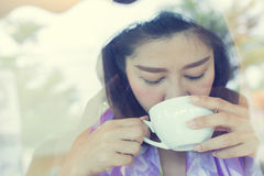 Female drinking hot coffee in cafe Royalty Free Stock Photos
