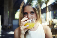 Female drinking natural vitamin beverage and looking at you Stock Photo