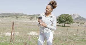 Female drinking water on workout stock video footage
