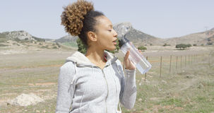 Female drinking water during workout Royalty Free Stock Photo