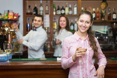 Female drinking wine at counter Royalty Free Stock Photo