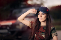 Female Driver in Army Outfit Next to an Off Road Car Stock Photo