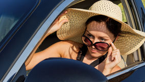 Female driver checking her side mirror Royalty Free Stock Photo