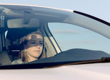 Female driver checking her side mirror Stock Photo