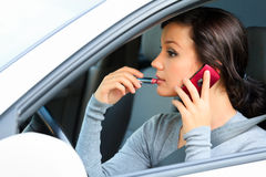 Female driver doing make-up. Stock Photos