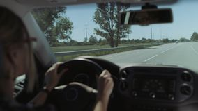 Female driver driving car on freeway on road trip stock footage