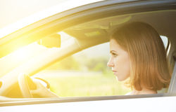 Female driver driving a car Stock Images