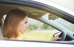 Female driver driving a car Stock Photo