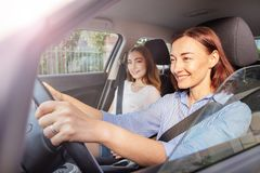 Female driver and girl passenger during road trip royalty free stock photo