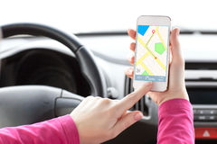 Female driver hand holding phone with interface navigator Royalty Free Stock Photography