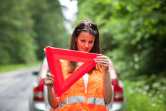 Female driver after her car has broken down Royalty Free Stock Photos