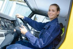 Female driver looking out truck Royalty Free Stock Photos