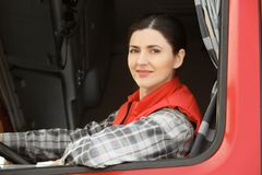 Female driver looking out of truck. Window stock photo