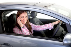 Female driver on a mobile phone Stock Photography