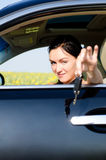 Female driver offering her car keys Royalty Free Stock Photography