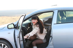 A female driver opens a car door. Girl opens a car door Royalty Free Stock Photography
